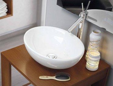 lavabo ovalado blanco de tipo sobre encimera